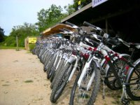 long rack of bikes in front of hire centre