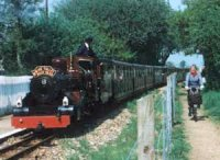 steam locomotive with train by cyclepath
