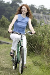 lady cycling white trousers blue top